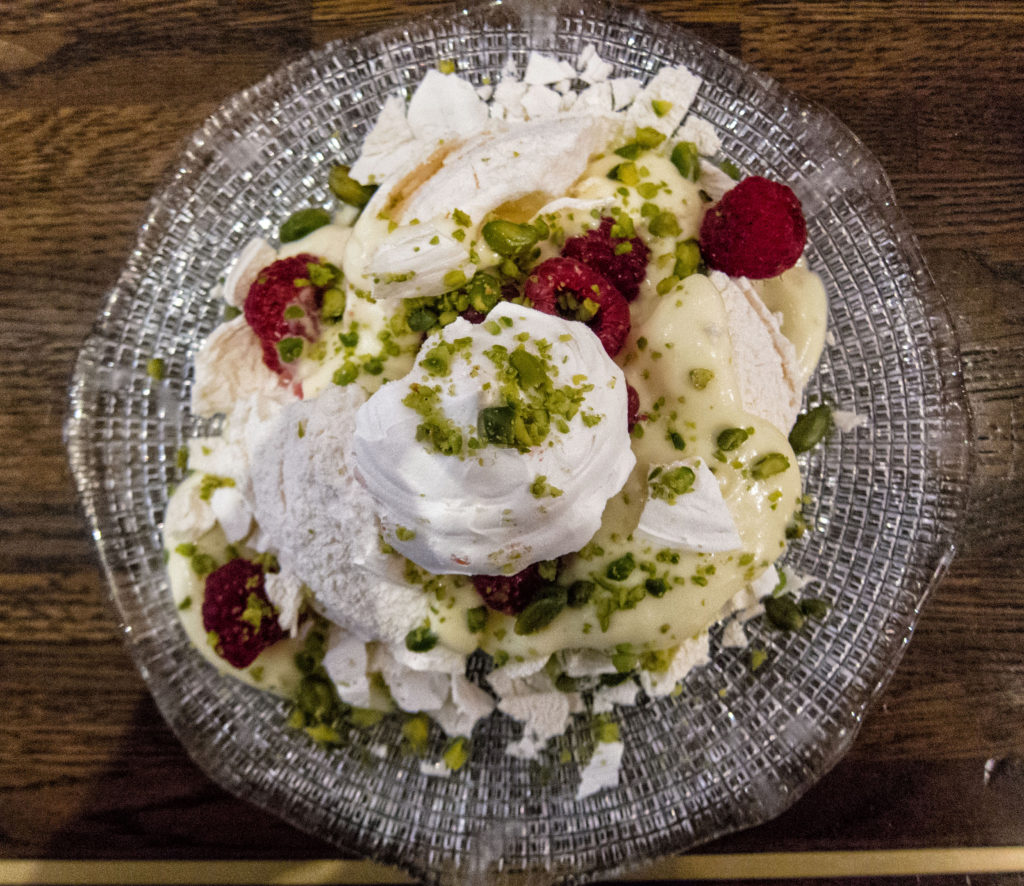 Pistachio meringue with lemon curd and raspberries at Cafe Murano