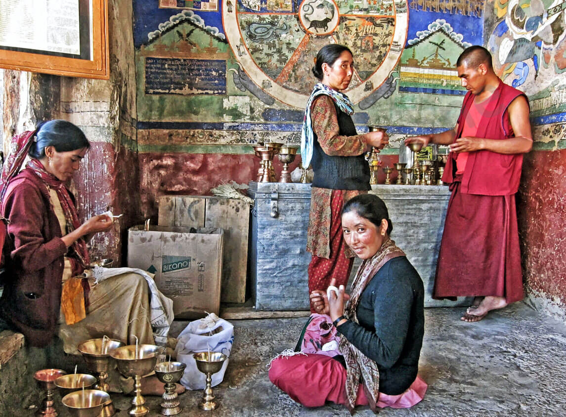 Travel in India: Village women and a Buddhist monk in Thiksey monastery, Ladakh