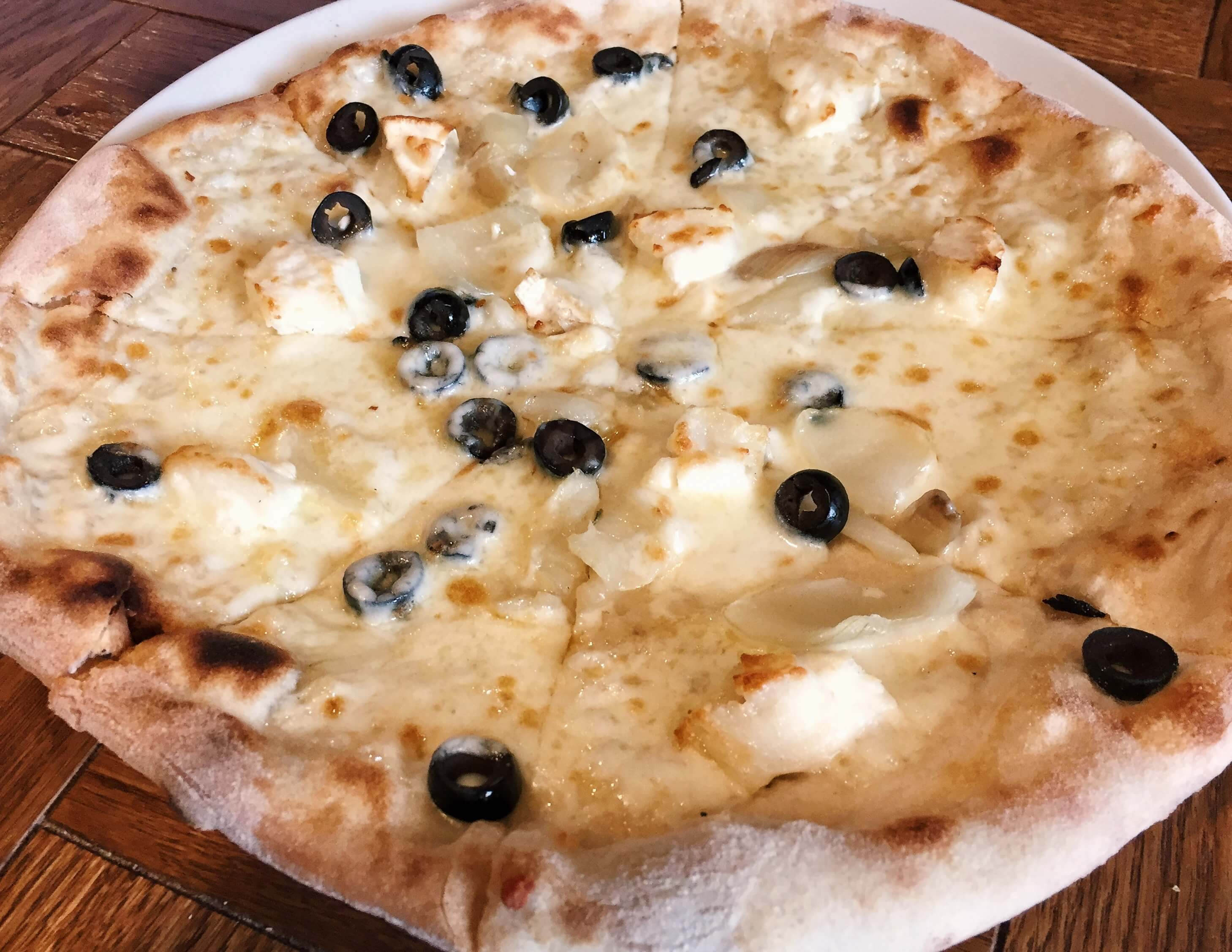 Goats cheese, roasted onion and black olive pizza from Firebrand in Marylebone, London