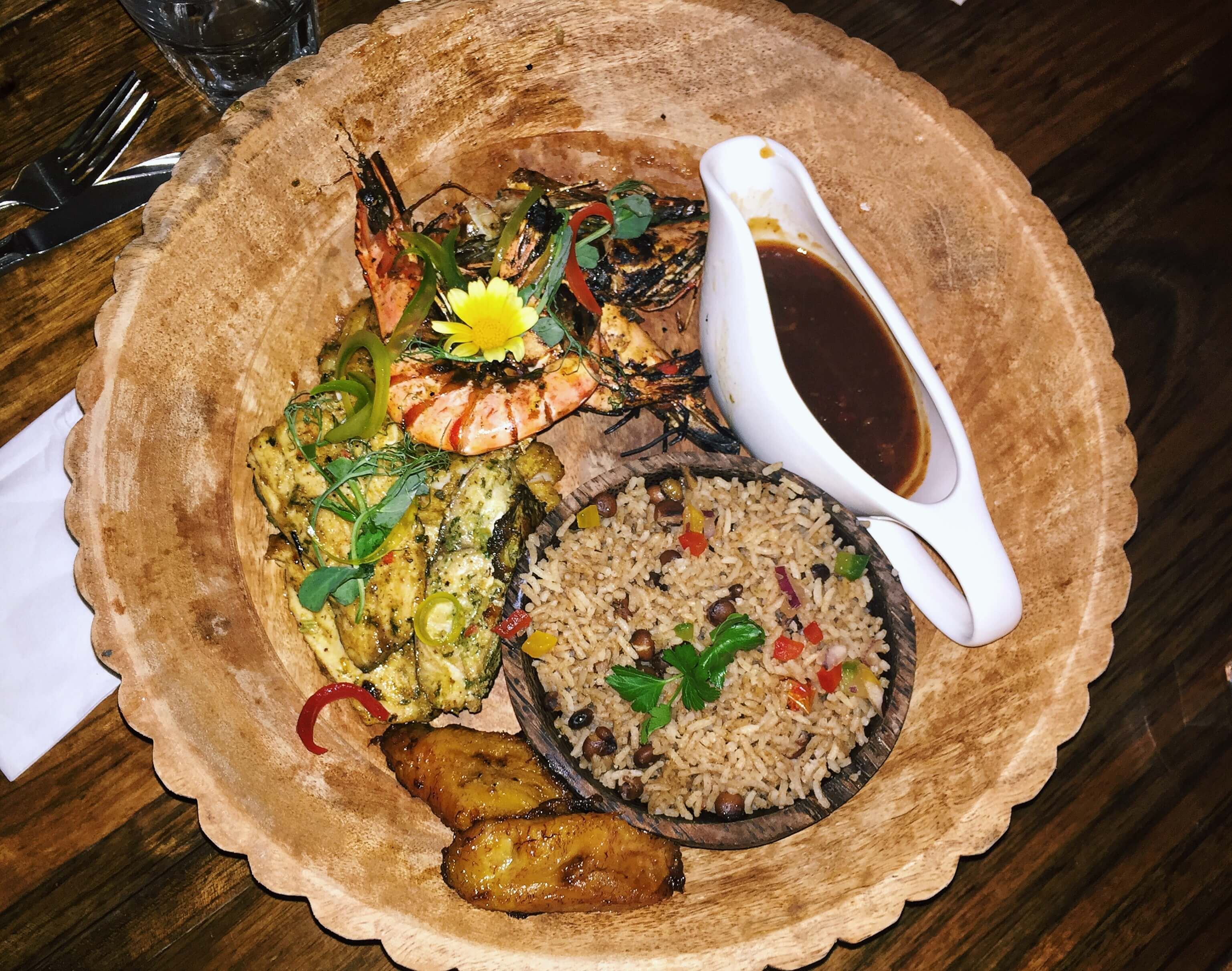 A seafood platter with rice and peas at Cottons Caribbean restaurant in Shoreditch, London