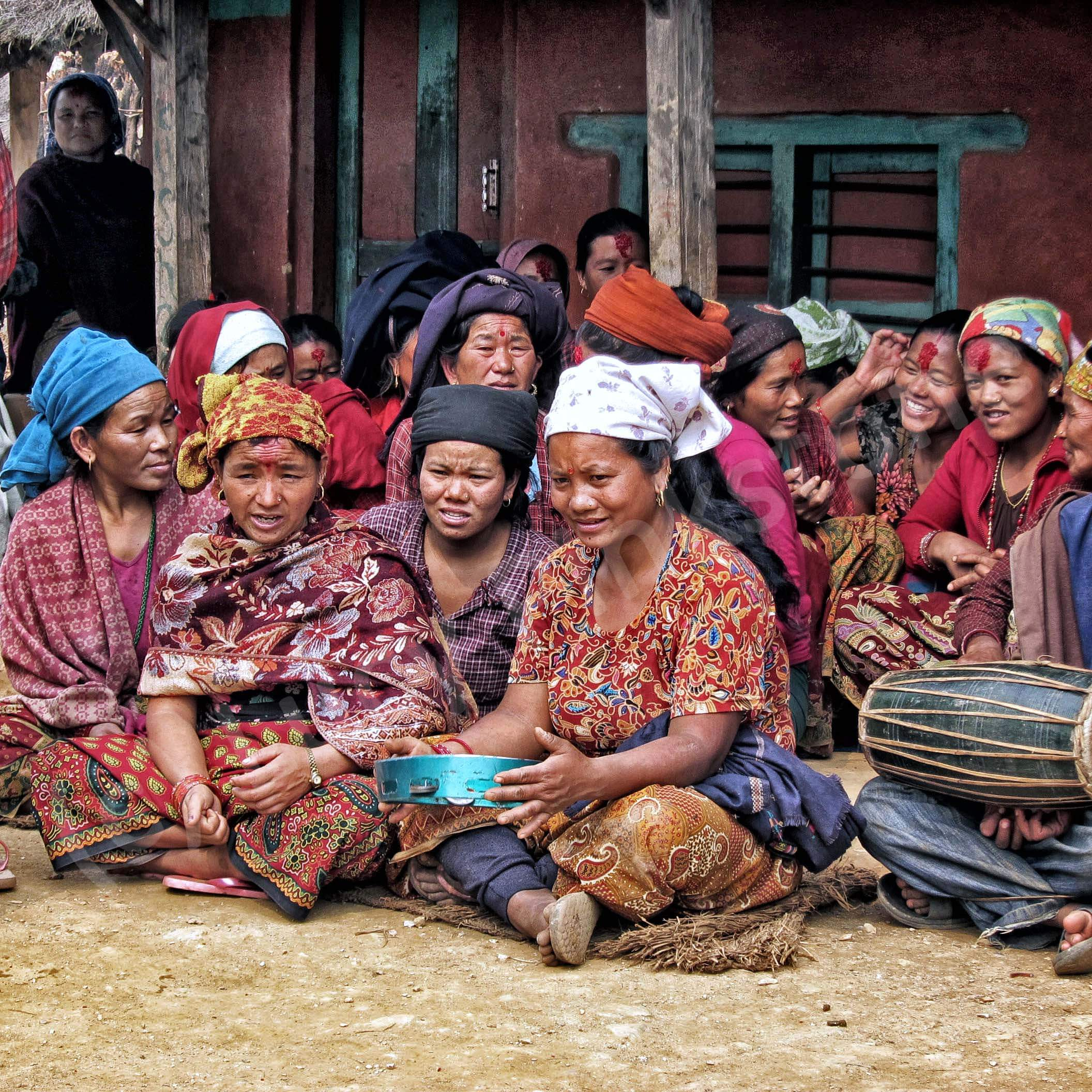 Travel photo: Women in village in Nepal playing musical instruments
