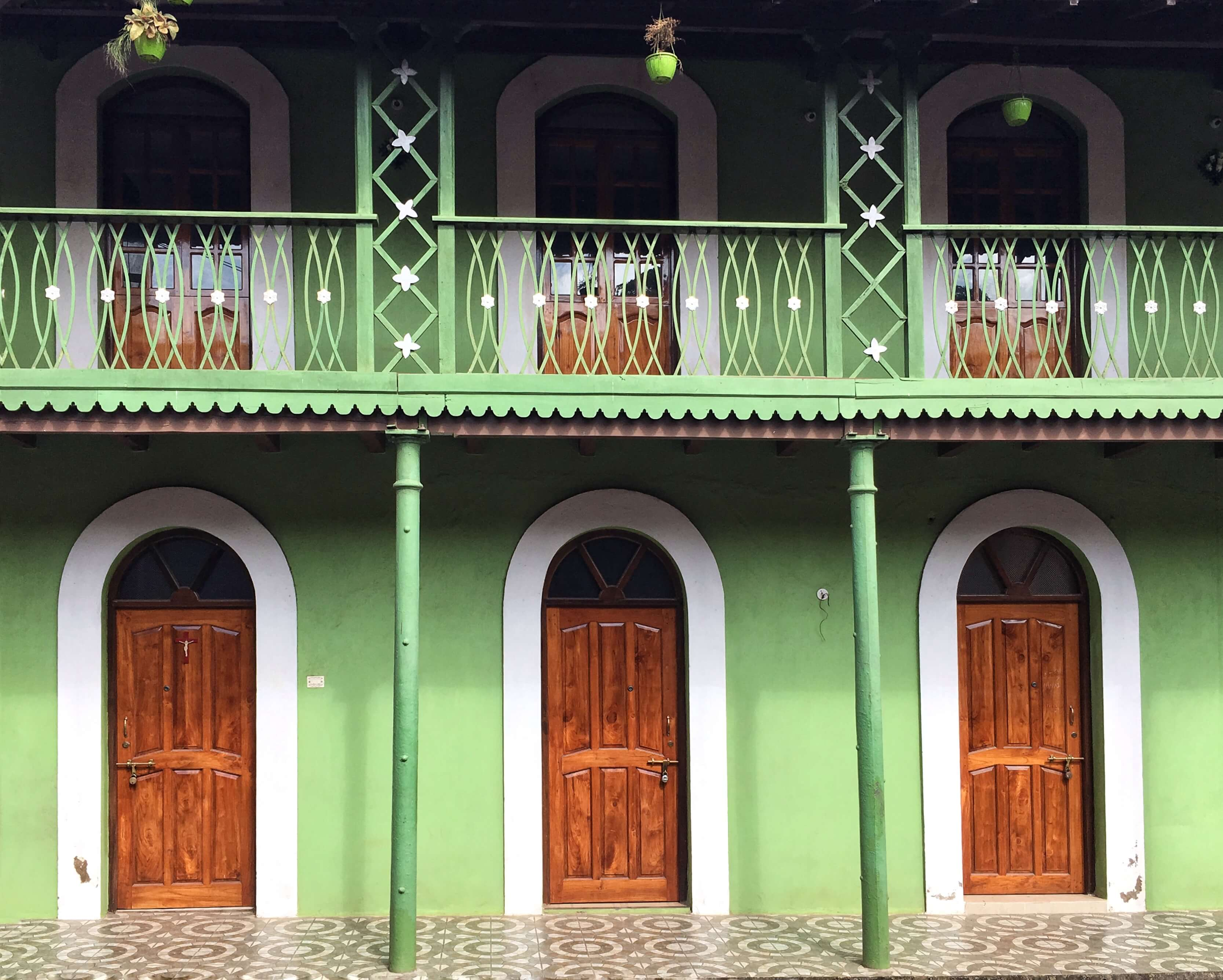 Green building with balcony in Panaji, Goa
