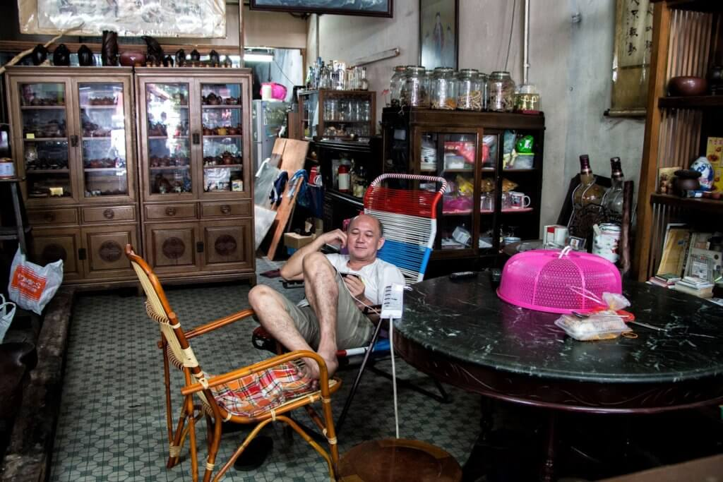 An antique shop and its owner in Melaka/Malacca, Malaysia