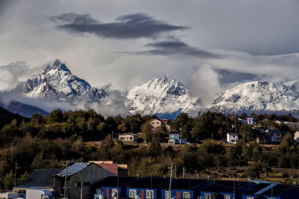 View of Ushuaia with snowcapped mountains in the background