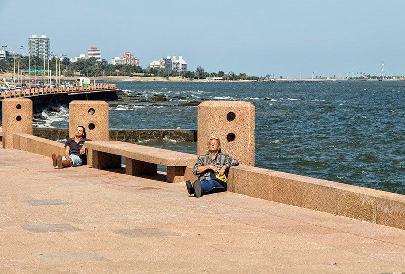 People sunbathing on the Rambla in Montevideo